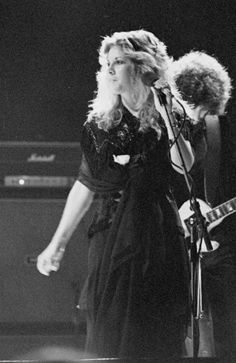 Stevie with her man Lindsey in the background playing some genius guitar work no doubt.