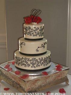 Black Scroll Wedding Cake  http://www.tortesntarts.com/gallery.html
