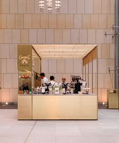 woods bagot positions brass coffee kiosk inside sydney tower