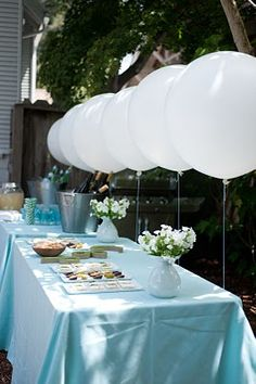 balloons behind the dessert table