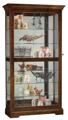 Curio Cabinet. Curio Cabinet offers a locking front door with beveled glass. Slides in both directions for convenient access to the shelves. Finished in Cherry Bordeaux on select hardwoods and veneers. Halogen lighting for brighter, whiter, longer lasting light to illuminate your collectibles. No-Reach roller light switch for interior light is conveniently located on the back of the cabinet.