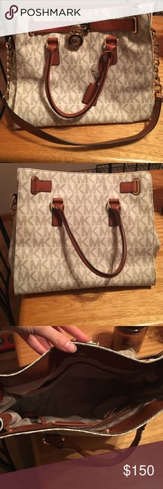 Michael Kors Large Hamilton purse This is a like new Michael Kors large Hamilton purse. It is a white purse with a gold colored MK all over it. Make me an offer  Michael Kors Bags Shoulder Bags