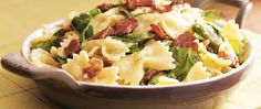 Macaroni and cheese goes upscale, featuring bow-tie pasta, bacon and spinach. This delicious dish can serve six in just 25 minutes.