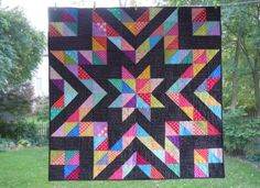 sparkle quilt made with HST alternated with Black squares.