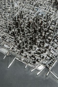 pieces of movable type from a printing press to create an elaborate cityscape