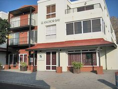 NO 2 ANCHOR BAY, Gordons Bay Self Catering Accommodation Cape Town - Well appointed and elegantly furnished 2 bedroom, 2 bathroom apartment situated 100m from the beach. Fully equipped kitchen includes washing machine and dryer. DStv and underground parking. The complex has a lift, swimming pool and gym. Sleeps 4 plus 2 kids.
