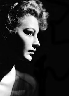 Ava Gardner, 1940s.  Great photography, especially the use of light, shadow, and negative space for a gorgeous profile photo.