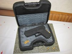 Glock Cake? Best cake EVAR! But not with a Glock, give me a Sig and I'll be one happy girl. :)