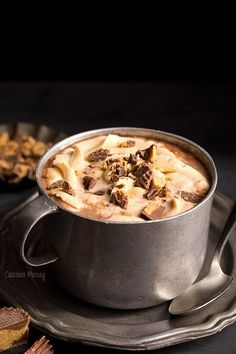 Put down the hot cocoa mix and warm up with Peanut Butter Hot Chocolate from scratch topped with homemade peanut butter whipped cream and chopped peanut butter cups.