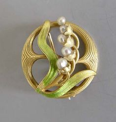 "pearl and enamel 7/8"" lily-of-the-valley pin."
