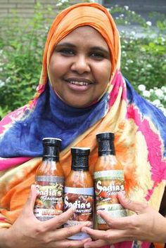 StarTribune- SOMALI IMMIGRANT EXPANDS BUSINESS WITH HER SECRET SAUCE  A Cub Foods store in Minneapolis brings to 86 the number of area retailers selling Sadia's Gourmet hot sauces.  Sadia Korad Abdi, who immigrated with her family from Somalia in 1999, was a lifelong cook working as a housekeeper in a nursing home in 2007 when she decided to turn her avocation into business.     Sadia's Gourmet sauces sell for up to $5 per 12-ounce bottle through retailers and her website www.sadiassauce.com