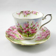 Beautiful bone china tea cup made by Royal Albert. Tea cup and saucer have trees with pink blossoms. Pattern is called Blossom Time. Gold trimming on cup and saucer edges. Excellent condition (see photos). The markings read: Royal Albert Bone China England Blossom Time For more items