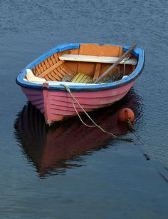 I would love to have a little wooden boat like  this again...like the ones we had as kids. There's a wooden boat builder near Betterton. I wonder if he would do a small custom job. :)