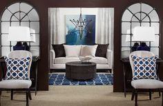 Summertime Blues contemporary living room. NOTES: Love the color, the huge window-shaped mirrors, the pillow fabric, the nailhead trim on the furniture and clean furniture lines, the unusual light pendant.  Would add in another complementary color in accents or rug or upholstery.