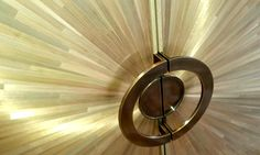 Bespoke bronze handles on a straw marqueted pop-up TV unit by INTERIOR-iD