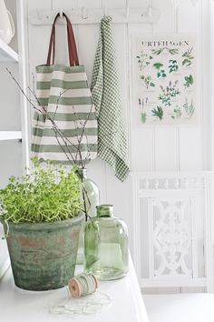 http://vibekedesign.blogspot.no/ white with green accents, and botanical print - love!