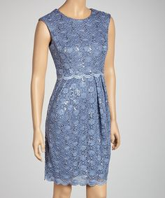 This fancy frock sports allover lace bedecked in sequins and a sleeveless silhouette, promising to flatter the figure while boasting undeniable style.