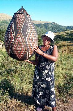 Africa   Mary Sibaya, proudly holding up her Zulu Wedding basket.   Image © ZanzibarTrading