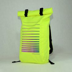 Lime green roll top rucksack with new reflective print for city, travels and cycling. Backpack is water resistant. FEATURES - Reflective safety pattern that are visible from all angles - Durable water resistant fabric Cordura 1000D - Inside fabric with water resistant coating - Easy