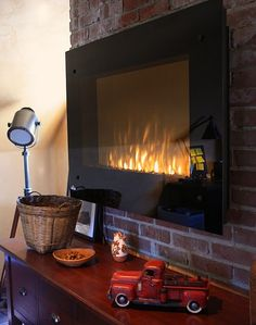 Instant Fireplace by Napoleon via familycircle: Electric wall fireplace which mounts like a flat screen TV, looks just like the real thing and operates with a remote. $720 Find it here: http://tinyurl.com/4376txq #Electric_Fireplace #Napoleon_Quality_Fireplaces