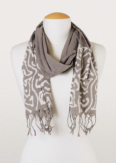 This 100% cotton scarf is a natural beauty! Featuring tassels and a sumptuous, swirling design, it's crafted using the traditional batik process.