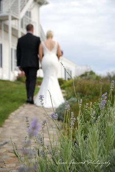 couple: focus on up close landscape, bride/groom walking away in distance