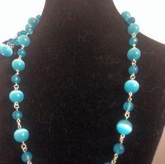 #parure #metallica in #occhiodigatto #azzurra  #necklace #earrings #bracelet in #metal with #catseyes in #blue   #conjunto #metalico con #ojodegato #azul   www.oro18.eu info@oro18.eu #oro18 #tuttobrillante #italia #italy #handmade #fattoamano #hechoamanos