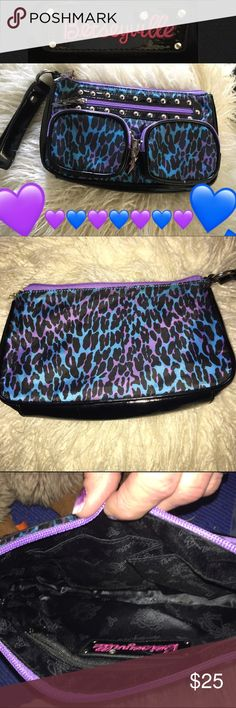 """Betsey Johnson """"Betsyville"""" wristlet Betsy Johnson """"BETSEYVILLE"""" purple and blue leopard nylon wristlet or cosmetic bag, 3 front, top and inside zippers for maximum storage. Black lpaten leather trim with Betsy Bill logo hardware. Excellent condition never been used Betsey Johnson Bags Clutches & Wristlets"""