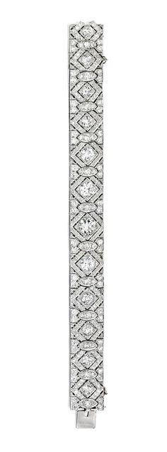 PLATINUM AND DIAMOND BRACELET.  The articulated strap of openwork design, set with 12 old European-cut diamonds weighing approximately 10.50 carats, accented by smaller old European and single-cut diamonds weighing approximately 8.75 carats, length 7¼ inches, circa 1930.