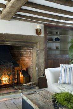 white ceiling agains exposed beams older fireplace - can it be set back ?