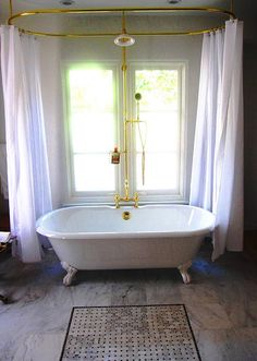 The Claw foot Tub Shower Curtain. I love t he double curtain idea!! And the gold is very bold!
