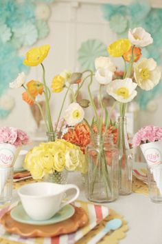 Cute little flowers and vases