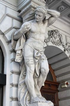 Brawny statue supporting a column on a renaissance palace. Metaphor of power Stock Photo