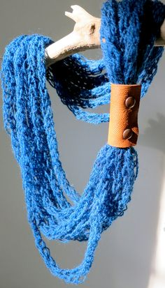 Hand-knit necklace with recycled leather closure in deep blue