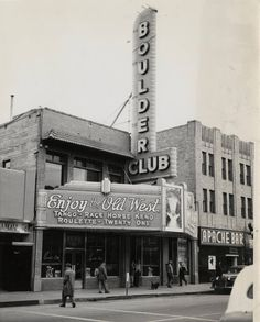 The new sign of the Boulder Club in downtown Las Vegas (1945). The Apache Bar is also seen to the right. Via the UNLV Collection