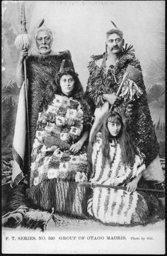 Gill, H J, fl 1912 :Group of Otago Maoris / photo by Gill. series no. A studio portrait showing a group of two men (standing) and two women (sitting), in traditional costume including feather cloaks. Each holds a weapon: two. Maori People, Tribal People, Maori Face Tattoo, Nz History, Asian History, Polynesian People, Maori Designs, Maori Art, Kiwiana