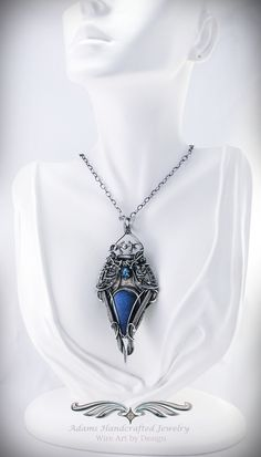 """Belisama""+--+from+the+'My+Heart'+Collection  A+bright+flashy+Labradorite+calling+to+mind+the+bluest+of+waters,+this+pendant+necklace+is+handcrafted+in+.999+fine+silver+that+has+been+antiqued+&+has+a+faceted+Swiss+Blue+Topaz+gemstone+(.90+ct)+to+accent+it.+The+chain+is+Adjustable,+16-20""+in+bot..."