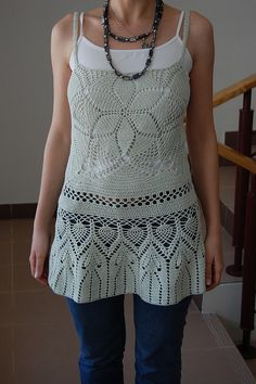 crochet top, I would bring this higher up on the bust line and make the body of it longer. Nice though.