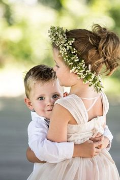 """Talk about adorable! We love this impromptu shot. What do you think? Isn't that floral crown is the perfect touch of whimsical? . Type """"love"""" in the comments if you feel the same way we do! . #whimsical #photoshoot #wedding #photographer #kids #love #boho #floral #2017"""