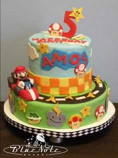 Mario Kart cake - nintendo theme - mario party - I know it's for a little kid, but Nate would be super excited for a birthday cake like that