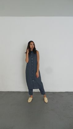 Sleeveless long dress Small mock neckline Button-front placket Mid-calf length EXCLUSIVELY DESIGNED FOR HUMAN & BEINGS Designed in Brooklyn, made in NY