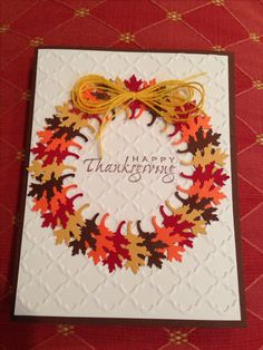 handmade Thanksgiving card ... wreath made of punched oak leaves ... luv how she put all the stems inside making it symmetrical ...