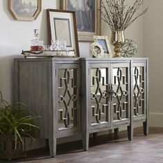 This four-door sideboard features antiqued mirrored glass set behind intricate, open scroll fretwork. The Hurley includes a fixed interior shelf, tapered ...