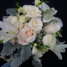 Bridal bouquet designed by Lilies White Floral Studio. Silver brunia, casa blanca lilies, roses, anemones, dusty miller.