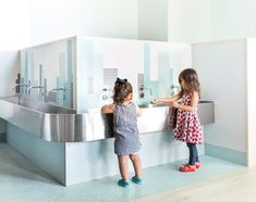 The school's mission inspired the development of graphic elements that relate to home and the city. In the bathroom, for instance, the team installed tilework that resembles a collection of buildings. Kindergarten Interior, Kids Toilet, Maple Floors, Bed Stuy, New York, Architecture Office, Landscape Architecture, Cultural Center, Large Homes