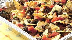 Grilled Picnic Taco Nachos recipe and reviews - Keep the heat outside with munchy nachos. A foil pan takes them from grill to picnic table in just minutes.