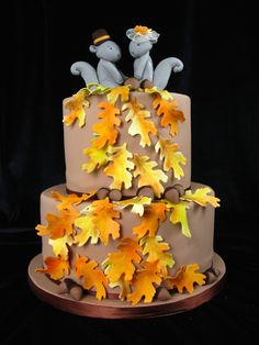 2 tier wedding cake, fall wedding, fall leaves, autumn wedding, squirrel toppers, bride and groom squirrel