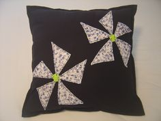 black, decorative pillow with patched, quilted flowers, home decor