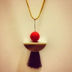 necklace with a red felt ball
