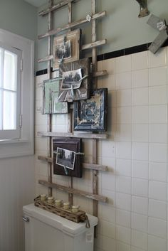 Bathroom or any room wall art using old photos and vintage trellis. This would be a great way to put all the pictures of the kids together. Love this!